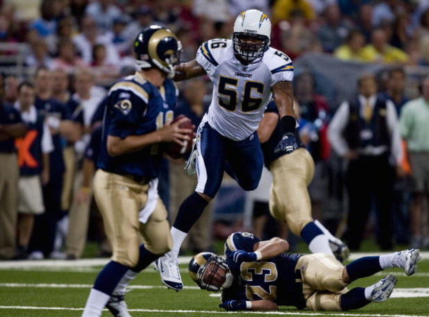 ST. LOUIS, MO - AUGUST 18: Shawne Merriman #56 of the San Diego Chargers hurdles Brian Leonard #23  of the St. Louis Rams as he looks to sack Marc Bulger #10 also of the St. Louis Rams on August 18, 2007 at the Edward Jones Dome in St. Louis, Missouri.  (