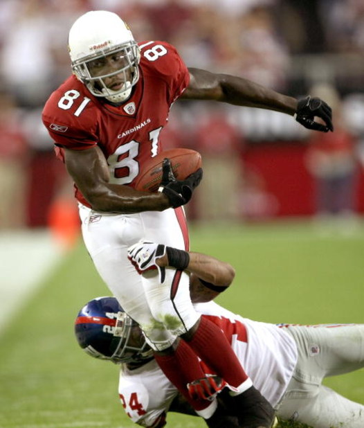 GLENDALE, AZ - NOVEMBER 23:  Wide receiver Anquan Boldin #81 of the Arizona Cardinals carries against cornerback Terrell Thomas #24 of the New York Giants on November 23, 2008 at University of Phoenix Stadium in Glendale, Arizona. The Giants won 37-29.  (