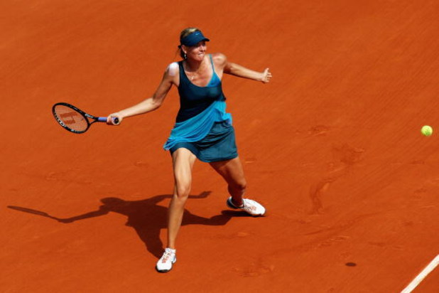 PARIS - MAY 25:  Maria Sharapova of Russia hits a forehand during the Women's First Round match against Anastasiya Yakimova of Belarus at the French Open at Roland Garros on May 25, 2009 in Paris, France.  (Photo by Ryan Pierse/Getty Images)