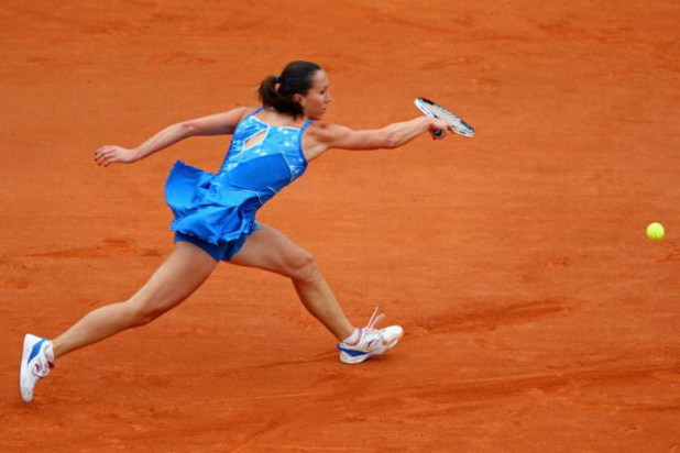 PARIS - MAY 26:  Jelena Jankovic of Serbia stretches to hit a backhand during her Women's Singles First Round match against Petra Cetkovska of the Czech Republic on day three of the French Open at Roland Garros on May 26, 2009 in Paris, France.  (Photo by