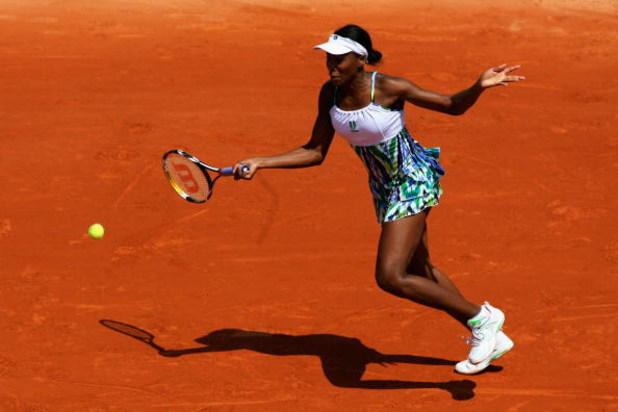 PARIS - MAY 25:  Venus Williams of USA hits a forehand during her Women's Singles First Round match against Bethanie Mattek-Sands of USA at the French Open at Roland Garros on May 25, 2009 in Paris, France.  (Photo by Matthew Stockman/Getty Images)