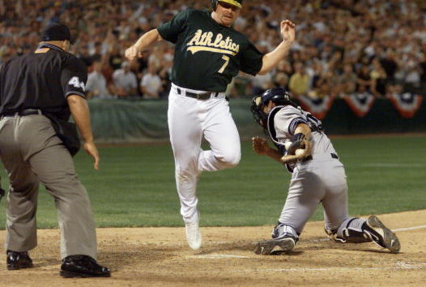 13 Oct 2001:  Jeremy Giambi of the Oakland A's is tagged out by Jorge Posada of the New York Yankees during game three of the American League Divisional Series at the Network Associaties Ceolesium in Oakland, Ca. < DIGITAL IMAGE> Mandatory Credit: Jed Jac