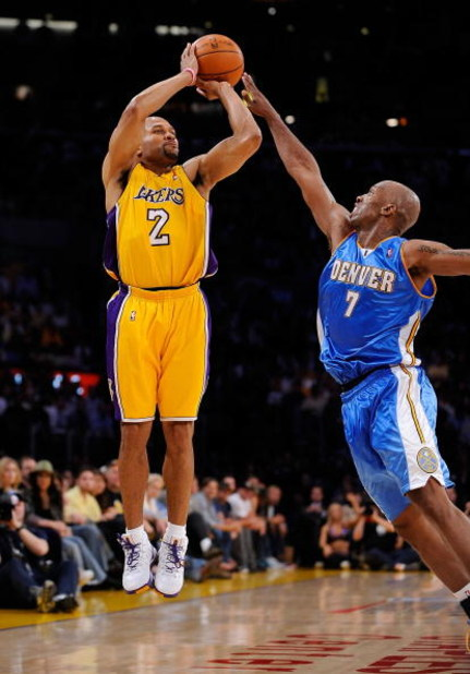 LOS ANGELES, CA - MAY 21:  Derek Fisher #2 of the Los Angeles Lakers shoots a jumper over Chauncey Billups #7 of the Denver Nuggets in Game Two of the Western Conference Finals during the 2009 NBA Playoffs at Staples Center on May 21, 2009 in Los Angeles,