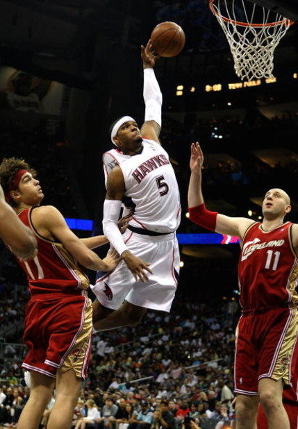 ATLANTA - MAY 09:  Josh Smith #5 of the Atlanta Hawks drives the basket against Zydrunas Ilgauskas #11 and Anderson Varejao #17 of the Cleveland Cavaliers in Game Three of the Eastern Conference Semifinals during the 2009 NBA Playoffs at Philips Arena on