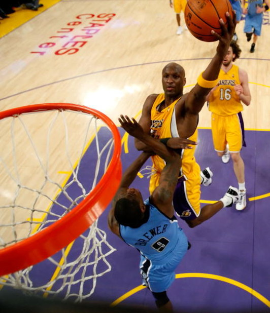 LOS ANGELES, CA - APRIL 27:  Lamar Odom #7 of the Los Angeles Lakers goes up for a shot over Ronnie Brewer #9 of the Utah Jazz in the first half of Game Five of the Western Conference Quarterfinals during the 2009 NBA Playoffs at Staples Center on April 2