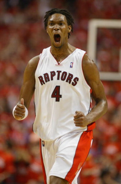 TORONTO,ON - APRIL 24:  Chris Bosh #4 of the Toronto Raptors shows his excitment against the Orlando Magic in Game 3 of the Eastern Conference Quarterfinals on April 24, 2008 at the Air Canada Centre in Toronto, Ontario. The Raptors defeated the Magic 108