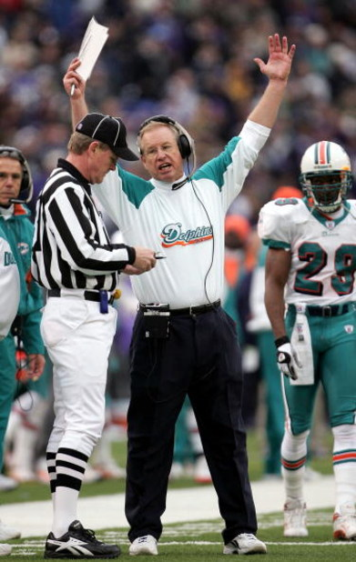 BALTIMORE - JANUARY 2:  Head coach Jim Bates of the Miami Dolphins protests a call with field judge Scott Steenson that nullified a touchdown call for the Dolphins in the fourth quarter as the Baltimore Ravens defeated the Dolphins 30-23 during NFL action