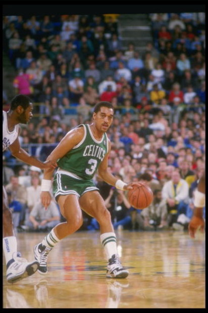 1987:  Guard Dennis Johnson of the Boston Celtics moves the ball during a game against the Golden State Warriors at the Coliseum Arena in Oakland, California. Mandatory Credit: Otto Greule Jr.  /Allsport