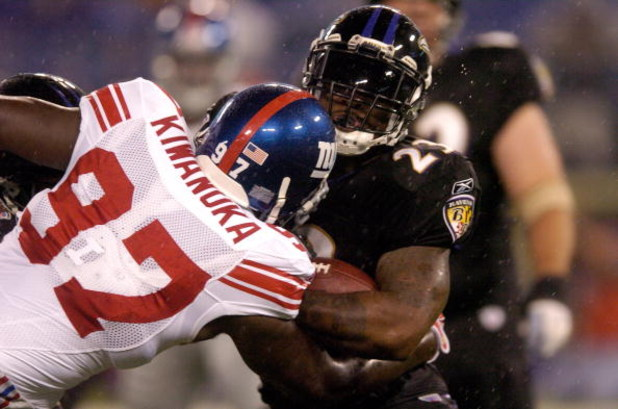 BALTIMORE, MD - AUGUST 19:  Willis McGahee #23 of the Baltimore Ravens is tackled by Mathias Kiwanuka #97 of the New York Giants during a preseason NFL game August 19, 2007 at M&T Bank Stadium in Baltimore, Maryland.  (Photo by Greg Fiume/Getty Images)