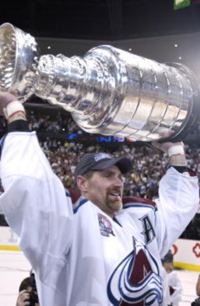 9 Jun 2001:  Ray Bourque #77 of the Colorado Avalanche lifts the Stanley Cup after they defeated the New Jersey Devils 3-1 in game seven of the NHL Stanley Cup Finals at Pepsi Center in Denver, Colorado.  The Avalanche take the series 4-3.  DIGITAL IMAGE.