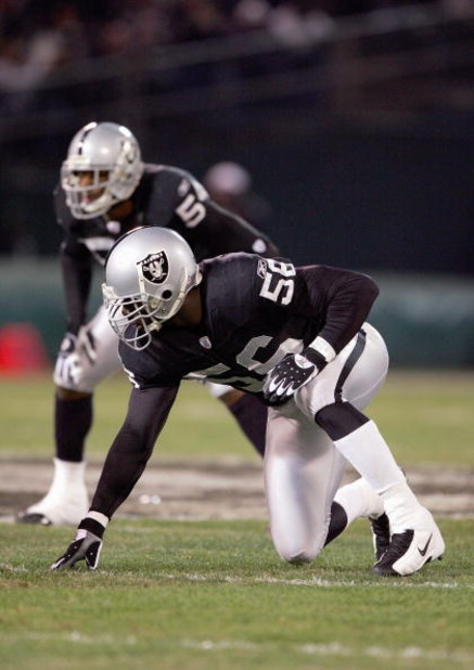 OAKLAND, CA - DECEMBER 23: Derrick Burgess #56 of the Oakland Raiders gets ready to move at the snap during the game against the Kansas City Chiefs at McAfee Coliseum on December 23, 2006 in Oakland, California. (Photo by Jed Jacobsohn/Getty Images)