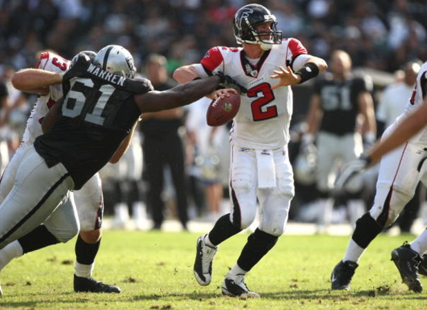 OAKLAND, CA - NOVEMBER 02:  Matt Ryan #2 of the Atlanta Falcons fumbles the ball as Gerard Warren #61 of the Oakland Raiders defends during an NFL game on November 2, 2008 at the Oakland-Alameda County Coliseum in Oakland, California.  (Photo by Jed Jacob