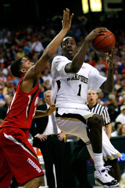 ATLANTA - MARCH 13:  Al-Farouq Aminu #1 of the Wake Forest Demon Deacons drives against Cliff Tucker #24 of the Maryland Terrapins during day two of the 2009 ACC Men's Basketball Tournament on March 13, 2009 at the Georgia Dome in Atlanta, Georgia.  (Phot