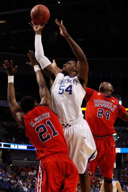 TAMPA, FL - MARCH 12:  Patrick Patterson #54 of the Kentucky Wildcats makes a shot over Malcom White #21 and Terrico White #24 of the Ole Miss Rebels during the first round of the SEC Men's Basketball Tournament on March 12, 2009 at The St. Pete Times For