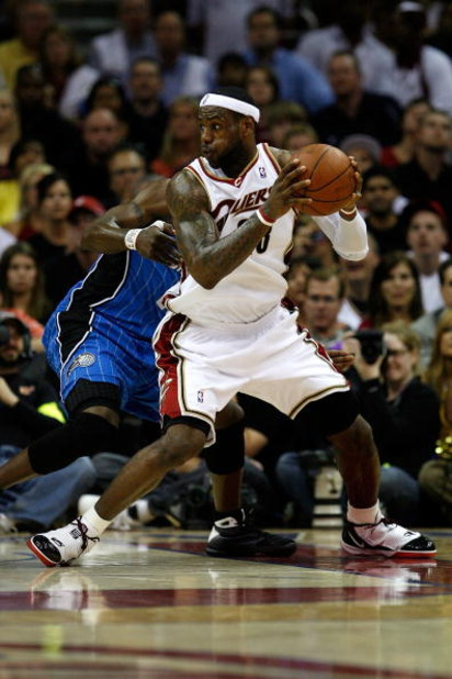 CLEVELAND - MAY 28:  LeBron James #23 of the Cleveland Cavaliers handles the ball against Mickael Pietrus #20 of the Orlando Magic in Game Five of the Eastern Conference Finals during the 2009 Playoffs at Quicken Loans Arena on May 28, 2009 in Cleveland,