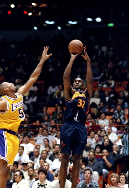 9 Nov 1997:  Forward Joe Smith of the Golden State Warriors (right) in action against forward Robert Horry of the Los Angeles Lakers during a game at the Great Western Forum in Inglewood, California.  The Lakers defeated the Warriors 132-97. Mandatory Cre