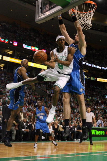 BOSTON - MAY 17:  Rajon Rondo #9 of the Boston Celtics passes the ball as Marcin Gortat #13 of the Orlando Magic defends Game Seven of the Eastern Conference Semifinals during the 2009 NBA Playoffs at TD Banknorth Garden on May 17, 2009 in Boston, Massach