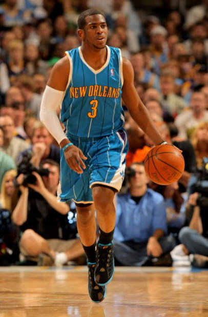 DENVER - APRIL 29:  Chris Paul #3 of the New Orleans Hornets brings the ball up court against the Denver Nuggets in Game Five of the Western Conference Quarterfinals during the 2009 NBA Playoffs at Pepsi Center on April 29, 2009 in Denver, Colorado. The N