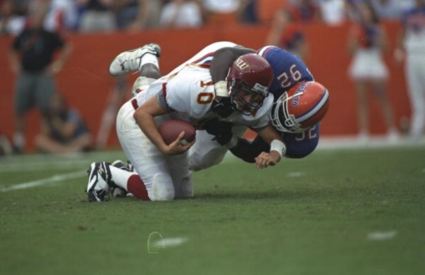 12 Sep 1998: Andres Vige #10 the N.E Louiisana is tackled by Reggie McGrew #92 of the Florida Gators at Folrida Field in Gainsville, Florida. Florida Gators defeated N,E Louisiana