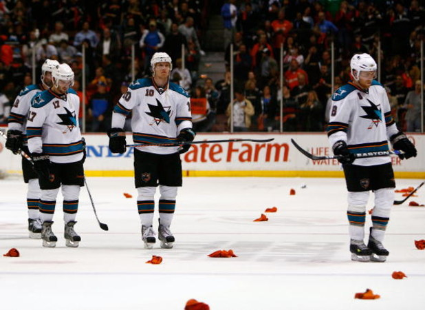 ANAHEIM, CA - APRIL 27:  Torrey Mitchell #17, Christian Ehrhoff #10 and Joe Pavelski #8 of the San Jose Sharks skate off the ice after being eliminated from the playoffs by the Anaheim Ducks in Game Six of the Western Conference Quarterfinal Round of the