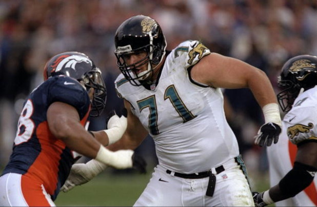25 Oct 1998: Tony Boselli #71 of the Jacksonville Jaguars pushes Maa Tanuvasa #98 of the Denver Broncos at Mile High Stadium in Denver, Colorado. The Broncos defeated the Jaguars 37- 24.