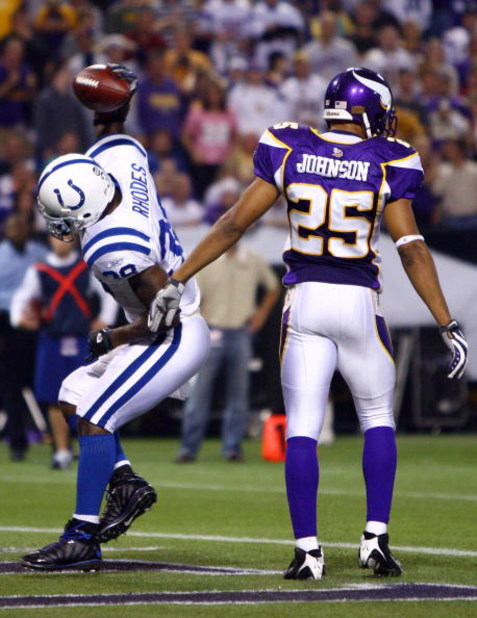 MINNEAPOLIS - SEPTEMBER 14:  Running back Dominic Rhodes #38 of the Indianapolis Colts celebrates after after scoring on a two-point conversion in front of Tyrell Johnson #25 of the Minnesota Vikings in the fourth quarter at the Metrodome on September 14,