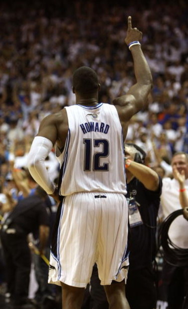 ORLANDO, FL - MAY 30:  Dwight Howard #12 of the Orlando Magic celebrates on the court after defeating the Cleveland Cavaliers in Game Six of the Eastern Conference Finals during the 2009 Playoffs at Amway Arena on May 30, 2009 in Orlando, Florida. NOTE TO