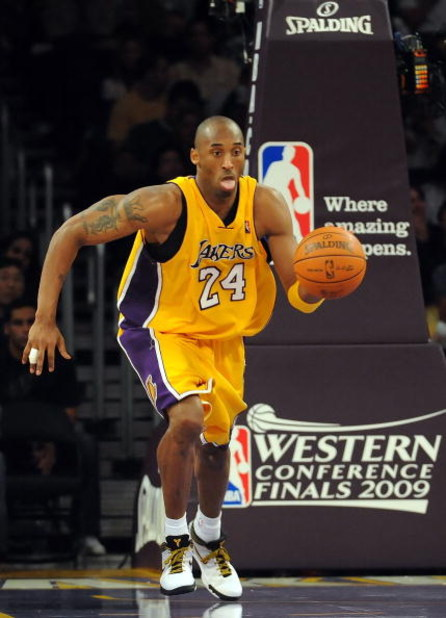 LOS ANGELES, CA - MAY 27:  Kobe Bryant #24 of the Los Angeles Lakers moves the ball against the Denver Nuggets in Game Five of the Western Conference Finals during the 2009 NBA Playoffs at Staples Center on May 27, 2009 in Los Angeles, California. NOTE TO