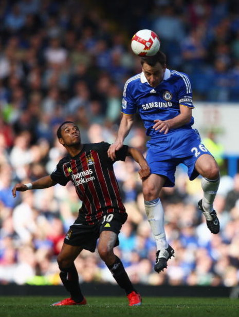 LONDON - MARCH 15: John Terry of Chelsea wins a header against Robinho of Manchester City during the Barclays Premier League match between Chelsea and Manchester City at Stamford Bridge on March 15, 2009 in London, England.  (Photo by Ryan Pierse/Getty Im