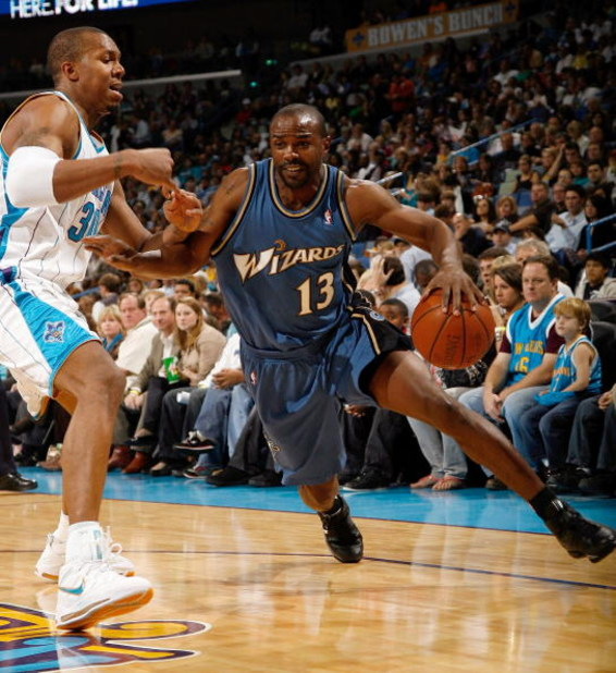 NEW ORLEANS - DECEMBER 30:  Mike James #13 of the Washington Wizards drives the ball around David West #30 of the New Orleans Hornets on December 30, 2008 at the New Orleans Arena in New Orleans, Louisiana.  NOTE TO USER: User expressly acknowledges and a