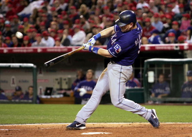 ANAHEIM, CA - APRIL 11:  Hank Blalock #9 of the Texas Rangers hits his second home run of the game against the Los Angeles Angels of Anaheim in the fourth inning on April 11, 2006 at Angel Stadium in Anaheim, California.  (Photo by Stephen Dunn/Getty Imag