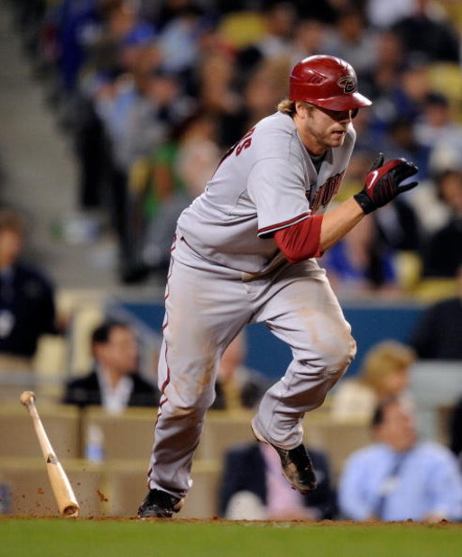 LOS ANGELES, CA - JUNE 01:  Mark Reynolds #27 of the Arizona Diamondbacks runs to first base after hitting into a force out to score Gerardo Parra from third base against the Los Angeles Dodgers  in the eight inning of the baseball game at Dodger Stadium