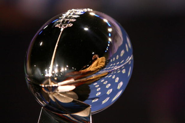TAMPA, FL - JANUARY 30:  The reflection of head coach Mike Tomlin of the Pittsburgh Steelers is seen in the Vince Lombardi trophy during the AFC Head coach press conference prior to Super Bowl XLIII held at the Tampa Convention Center on January 30, 2009