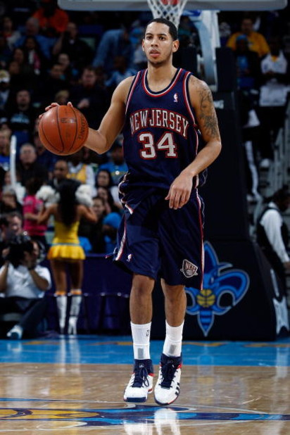 NEW ORLEANS - JANUARY 21:  Devin Harris #34 of the New Jersey Nets dribbles against the New Orleans Hornets on January 21, 2009 at the New Orleans Arena in New Orleans, Louisiana. The Hornets defeated the Nets 102-92.   NOTE TO USER: User expressly acknow