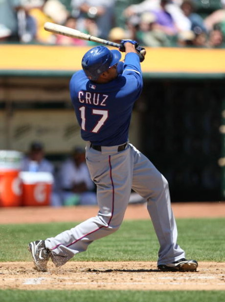 OAKLAND, CA - MAY 07:  Nelson Cruz #17 of the Texas Rangers bats against the Oakland Athletics during a Major League Baseball game on May 7, 2009 at the Oakland Coliseum in Oakland, California.  (Photo by Jed Jacobsohn/Getty Images)