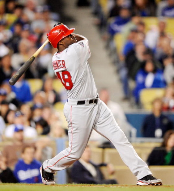 LOS ANGELES, CA - MAY 23:  Torii Hunter #48 of the Los Angeles Angels of Anaheim hits a three-run home run off pitcher randy Wolf of the Los Angeles Dodgers during the fifth inning of the baseball game at Dodger Stadium on May 23, 2009 in Los Angeles, Cal