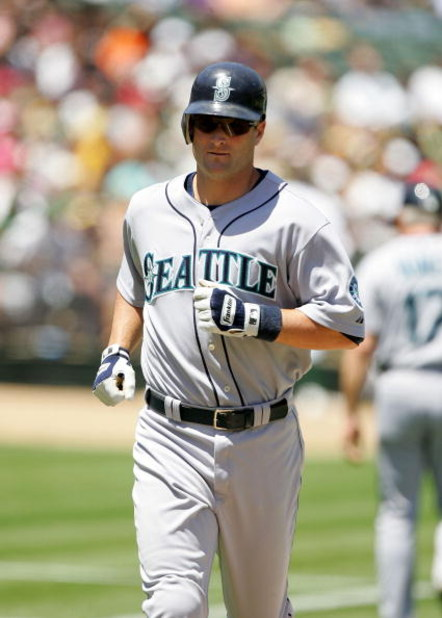 OAKLAND, CA - MAY 27: Russell Branyan #30 of the Seattle Mariners crosses home plate after hitting a two run home run in the sixth inning of their game against the Oakland Athletics at the Oakland Coliseum on May 27, 2009 in Oakland, California.  (Photo b