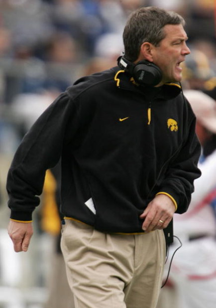 STATE COLLEGE, PA - OCTOBER 23:  Head coach Kirk Ferentz of the Iowa Hawkeyes leads his team against the Penn State Nittnay Lions as the Iowa Hawkeyes defeated Penn State Nittnay Lions 6-4 during NCAA football at Beaver Stadium on October 23, 2004 in Stat