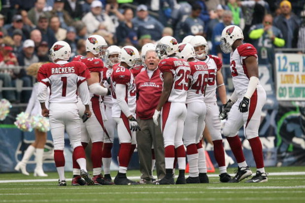 SEATTLE - NOVEMBER 16:  Special teams coach Kevin Spencer of the Arizona Cardinals huddle with his team on the field during the game against the Seattle Seahawks on November 16, 2008 at Qwest Field in Seattle, Washington. (Photo by Otto Greule Jr/Getty Im
