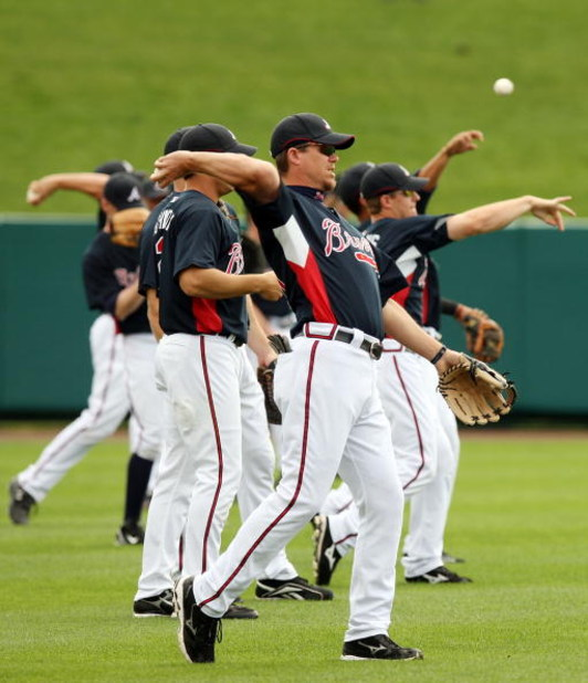 KISSIMMEE, FL - FEBRUARY 25:  Chipper Jones #10 of the Atlanta Braves and the rest of his teammates throw the ball during practice on February 25, 2008 at Disney's Wide World of Sports in Kissimmee, Florida.  (Photo by Elsa/Getty Images)