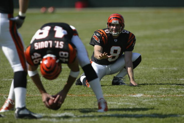 CINCINNATI - SEPTEMBER 29:  Kick holder Nick Harris #8 of the Cincinnati Bengals looks to receive the football from teammate long snapper Brad St. Louis #48 during warms ups before the game against the Tampa Bay Buccaneers on September 29, 2002 at Paul Br
