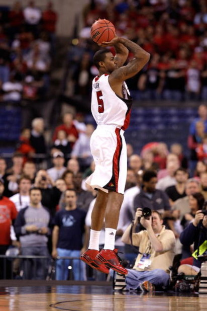 INDIANAPOLIS - MARCH 27:  Earl Clark #5 of the Louisville Cardinals attempts a shot against the Arizona Wildcats during the third round of the NCAA Division I Men's Basketball Tournament at the Lucas Oil Stadium on March 27, 2009 in Indianapolis, Indiana.