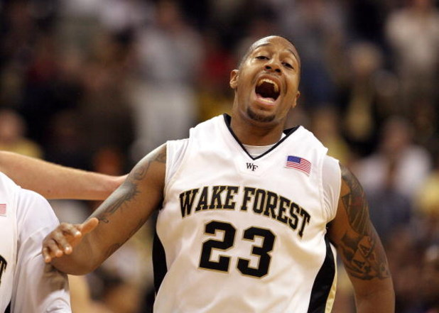 WINSTON-SALEM, NC - FEBRUARY 26: James Johnson #23 of the Wake Forest Demon Deacons reacts to a dunk against the North Carolina State Wolfpack during the Demon Deacons 85-78 victory at Lawrence Joel Coliseum on February 26, 2009 in Winston-Salem, North Ca
