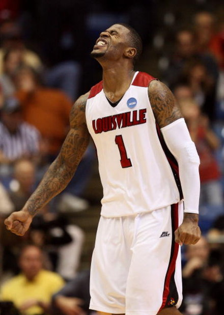 DAYTON, OH - MARCH 22:  Terrence Williams #1 of the Louisville Cardinals reacts after a play late in the game against the Siena Saints during the second round of the NCAA Division I Men's Basketball Tournament at the University of Dayton Arena on March 22