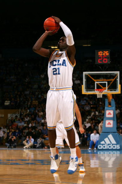 WESTWOOD, CA - MARCH 05:  Jrue Holiday #21 of the UCLA Bruins shoots the outside jump shot in the second half during their NCAA basketball game against the UCLA Bruins at Pauley Pavilion on March 5, 2009 in Westwood, California. The Bruins defeated the Be