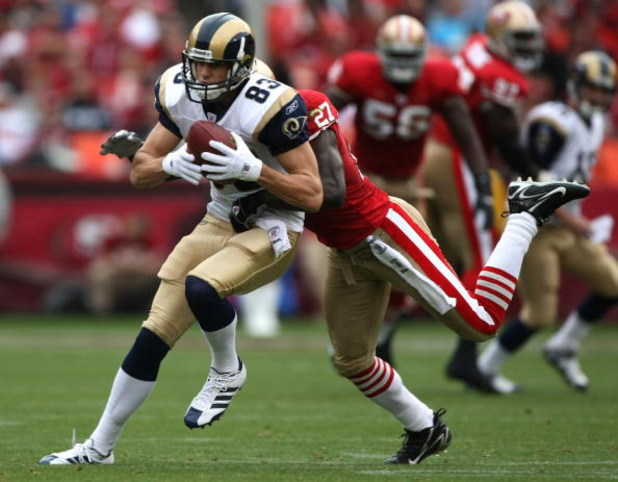 SAN FRANCISCO - NOVEMBER 18:  Drew Bennett #83 of the St. Louis Rams catches a pass over Walt Harris #27 of the San Francisco 49ers at Monster Park November 18, 2007 in San Francisco, California.  (Photo by Jed Jacobsohn/Getty Images)