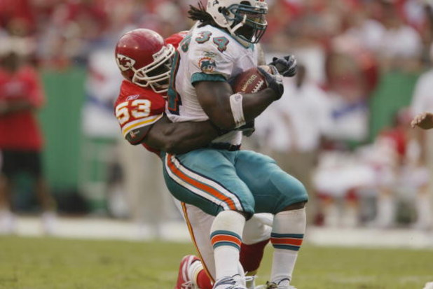 KANSAS CITY, MO - SEPTEMBER 29:  Linebacker Marvcus Patton #53 of the Kansas City Chiefs tackles running back Ricky Williams #34 of the Miami Dolphins during the NFL game on September 29, 2002 at Arrowhead Stadium in Kansas City, Missouri.  The Chiefs won
