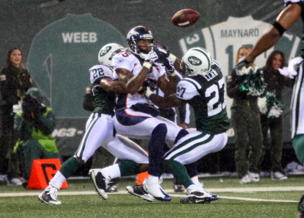 EAST RUTHERFORD, NJ - NOVEMBER 30:  Brandon Marshall #15 of the Denver Broncos can't make the catch as he defended by Ty Law #22 and Abram Elam #27 of the New York Jets on November 30, 2008 at Giants Stadium in East Rutherford, New Jersey. The Broncos def