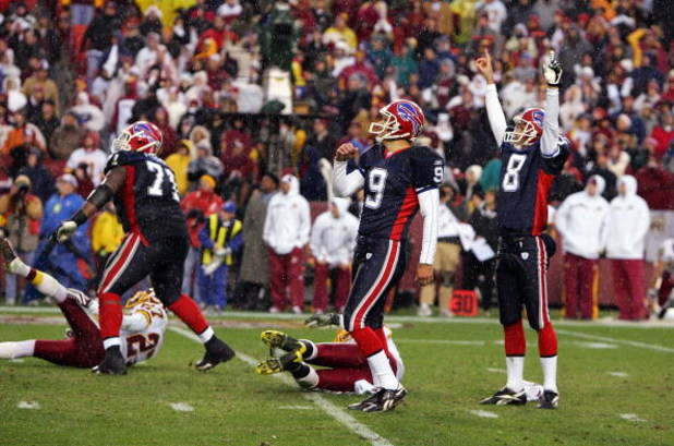 LANDOVER, MD - DECEMBER 02:  Rian Lindell #9 of the Buffalo Bills watches his game winning field goal against the Washington Redskins with teammates Brian Moorman #8, and Jason Peters #71 on December 2, 2007 at FedEx Field in Landover, Maryland.  (Photo b