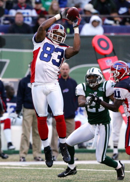 EAST RUTHERFORD, NJ - OCTOBER 28:  Lee Evans #83 of the Buffalo Bills goes up for a reception against the New York Jets at Giants Stadium October 28, 2007 in East Rutherford, New Jersey.  (Photo by Jim McIsaac/Getty Images)